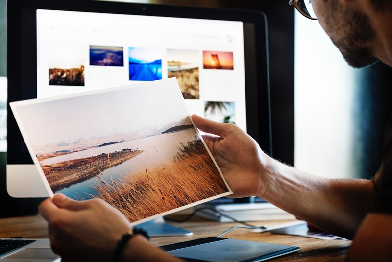 the future of remote working-man printing photos